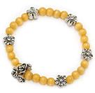黄色猫眼石手链 配藏银花 单圈圆珠弹力线款