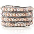 天然珍珠皮绳手链  四层皮绳编织缠绕款