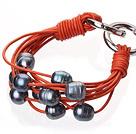 天然黑色珍珠手链 配橘色皮绳 多层皮绳款